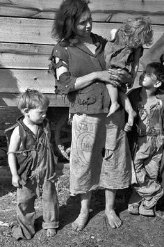 """Figure 1.--The FSA-SPS caption read, """"Mother and baby of family of nine living in field on U.S. Route 70 near the Tennessee River."""" The photograph was taken in Msrch 1936. Source: Carl Mydans, Farm Security Administration."""