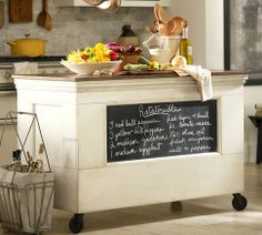 SHELTON KITCHEN ISLAND  $999.00 - The cash wrap in a country general store was the inspiration for this piece. Crafted with a chalkboard front, two open shelves in back and rugged casters for mobility, it adds storage and functionality to the kitchen or home office.