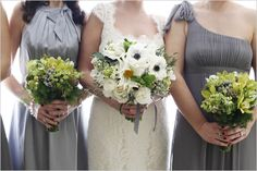 love the mismatched gray dresses and the bride's bouquet!