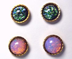 DETAILS:    -11mm vintage gold tone diamond cut post earring settings (new/unused bezels from the 1980s)  -Stone (top pair): Vintage glass silver/pink opal cabochons (new/unused from the 1940s and made in Germany )  -Stone (bottom pair): 11mm emerald green/blue fire opal glass Czech cabochons  -Includes butterfly earring backs      This gorgeous set includes two pairs of classic, yet eye-catching 11mm round stud earrings in vintage gold tone diamond cut post earring bezels. The bezel…