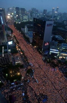 Protest with candles in Korea wanting president to resign