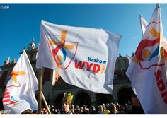 Young people wave flags ahead of the World Youth Day 2016 event in Krakow, Poland - AFP