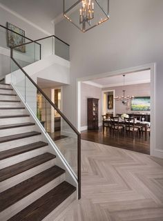 Foyer flooring ideas staircase transitional with dark wood staircase glass stair railing herringbone floor herringbone wood floor Modern Stair Railing, Stair Railing Design, Staircase Railings, Modern Stairs, Railing Ideas, Bannister, Staircases, Tile Stairs, Glass Stairs