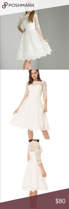 NWT Chi Chi London Flora Dress White Walk down the aisle in this beautiful tea length lace dress. Dress has 3/4 length sleeves with built in layers of tulle. Sizing is UK. Length from side seam: 32in. Chi Chi London Dresses Midi