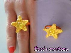 Anello con stella e strass centrale:)