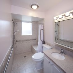 accessible #bathroom. roll up sink. 2 simple grab bars. ceiling