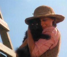 love this photo -- screenshot of Sarah Plain and Tall, Sarah loving on a black kitty.