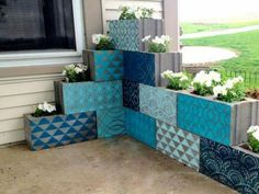 Colorful Painting Ideas for Concrete Planters Saving Money on Yard Decorations