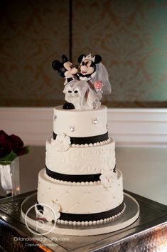 Gorgeous Black White and Crystal cake from Party Flavors Custom Cakes inspired by Disney with Mickey and Minnie Mouse.