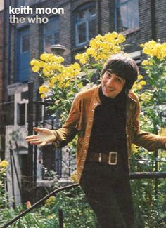 Keith Moon...if only his life had been as bright and beautiful as the flowers behind him ;(