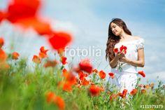 """Téléchargez la photo libre de droits """"Girl in a field of poppies"""" créée par Evgenia Tiplyashina au meilleur prix sur Fotolia.com. Parcourez notre banque d'images en ligne et trouvez l'image parfaite pour vos projets marketing !"""