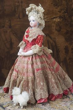 Very beautiful fashion doll with pale bisque, sturdy body with rare bisque hands, gorgeous antique silk gown! Bisque swivel head on kid-edged bisque shoulder plate, small blue glass inset eyes, dark Gaultier. Victorian Dolls, Antique Dolls, Vintage Dolls, Doll Costume, Costumes, Barbie Gowns, Doll Dresses, Indian Dolls, Arte Popular