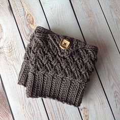 This is a PDF crochet pattern for a uniquely-textured pair of boot cuffs that can be made in any size using custom measurements, or by using the size chart included.