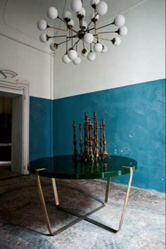 gorgeous blue walls, modern pendant lighting and elegant custom table, Dimore Studio