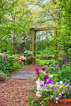 35 Beautiful Backyards Inviting entrance An arbor supporting summer-blooming clematis and honeysuckle leads to a prairie garden in this Illinois backyard. Twig chairs and a sculpture made from old garden and farm implements add whimsy. Garden Gates, Garden Art, Garden Design, Prairie Garden, Garden Cottage, Clematis, Woodland Garden, My Secret Garden, Hidden Garden