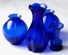 A grouping of cobalt vases