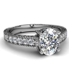 Oval Shaped Diamond Engagement Rings With White Diamond In 950 Platinum   Rim Design Ring   Fascinating Diamonds