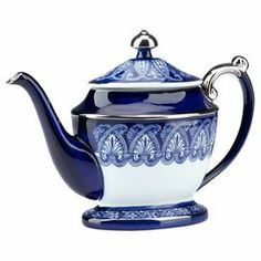 Art Deco-style porcelain teapot in hand-painted blue and white with silver trim and classic ornamentation.
