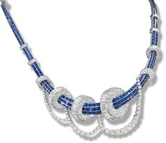 Sapphire and diamond necklace, 1950s. Designed as lines of calibré-cut sapphires passing through baguette and brilliant-cut diamond graduated discs, suspending a brilliant-cut diamond festoon, mounted in platinum,