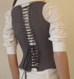 Underbust Bodice back. Also gives me an idea for a waistcoat. Definitely giving this a go!