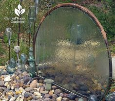 From 'Central Texas Gardener', learn how Elayne Lansford made this glass table top into a water wall!