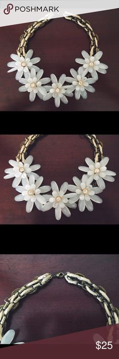 Anthropologie White Floral Bib Necklace Gorgeous slightly translucent white necklace with crystal in the center of each flower. Twill braided detailing with lobster clasp. Bib style. Never worn because I go to a conservative school. Anthropologie Jewelry Necklaces