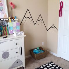 Tape wall art mountains using electric tape in girls room.