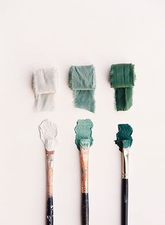 The element of color is shown through the paint on the brushes and how it contrasts with the pale background.