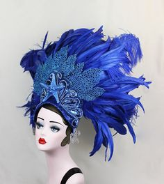 This headdress is the perfect accessory for a glamorous mermaid. The base sequined and beaded with glittery fans of leaves that look like fan coral and a huge hand painted and a glittered starfish in