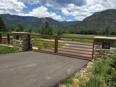 Contemporary custom drive gate with a natural rust finish (not recommended fro humid climates)