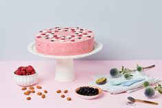 a whole round pink cake on a white holder, surrounded with berries and almonds Saint Stephen, National Holidays, Evo, Budapest, Mousse, Berries, Cake, Almonds, Pink