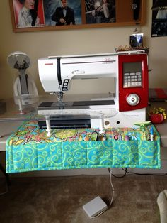 Sewing machine mat with all my doodads.