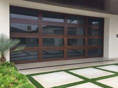 Modern Glass with Aluminium Frame Garage Door. https://www.pinterest.com/avivbeber3/glass-gates-and-garage-doors/