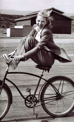 Cate Blanchett by Annie Leibovitz - Black and white photography - Smile when riding a bike