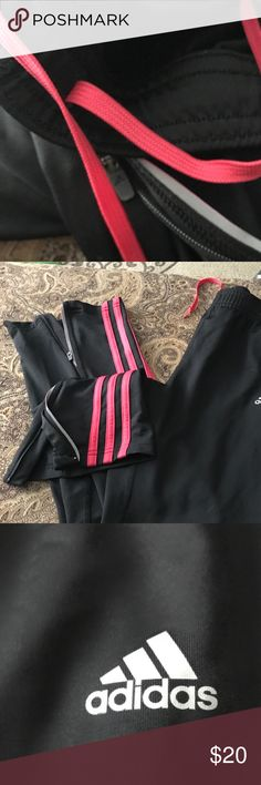 Adidas Response Black Track Pant With Pink Stripes Size Small, worn twice. Pink Adidas stripes on black background with pink tie and back zip pocket. adidas Pants Track Pants & Joggers