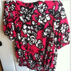 Rafaella blouse, size L Beautiful fuchsia, black & white blouse. In the pictures it looks more red except the last one shows the hot pink a little better but still not good. Elastic around waist. 92% polyester, 8% spandex. Very light & flattering top! Rafaella Tops Blouses