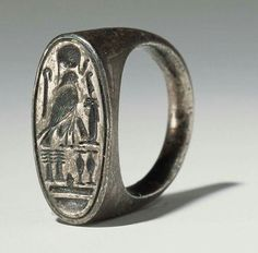 Silver ring belonging to Ramesses IV (1153-1147 B.C.) New Kingdom,20th Dynasty (1200-1085 B.C.).Signet rings were traditionally used as formal stamps which were clear and easy ways to identify people.This was done by pressing the ring into a soft, wet material,such as hot wax, that would then harden with the ring's image moulded into it.In the Middle Ages,nobles and aristocrats wore them to show their allegiance to a specific king or royal family