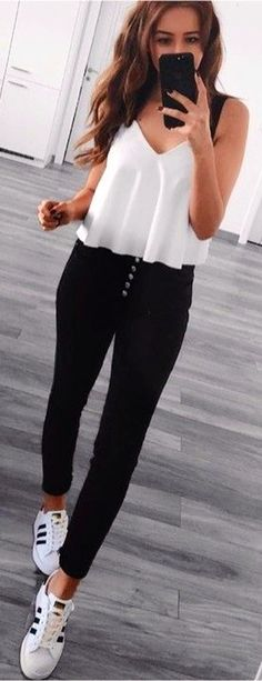 #spring #outfits woman wearing white v-neck sleeveless shirt and black fitted pants. Pic by @find_my_style