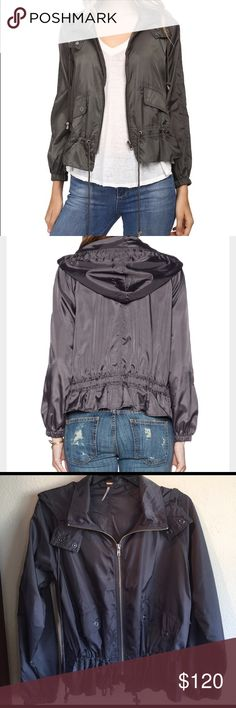 Free people parachute jacket NWT gray  Free People ripstop parachute hooded jacket. This jacket is so cute but practical. Perfect for a rainy day or just to wear when you don't need a heavy jacket. Feel free to ask any questions. Free People Jackets & Coats