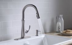 Bellera kitchen faucet, by Kohler Co.  Brushed stainless to go with the fridge or oil rubbed bronze to go with the switchplates/curtain rods/fans ????