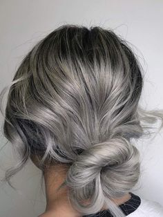 Many women color their hair to keep the grays away, but thanks to standout stylists, silver strands are no longer something to fear. If you're love to be at the forefront of big trends, make an appointment with your colorist for this head-turning look ASAP. #haircolor #hairtrends #hairstyle #silverhair