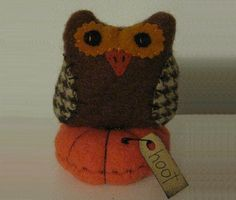 """Harvest Owl  Handstitched wool. Tufted cushion. Hang tag reads, """"hoot"""". 4"""" high."""