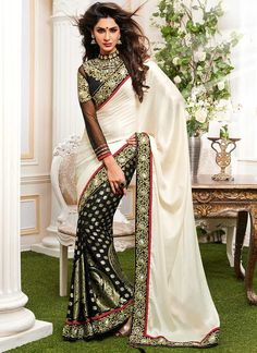 Everyone Will Admire You When You Wear This Clad To Elegant Affairs.  Style And Trend Will Be At The Peak Of Your Beauty When You Attire This Black & Off White Viscose Georgette Saree.  This Ravishing Attire Is Amazingly Embroidered With Chikan Work, Cord Work, Multi & Resham Work.