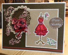 Claire Pearson Love the dress, this was done by stamping onto Kraft card, covering with gesso then restamping and colouring then outlined with a correction pen