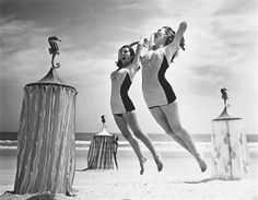 Models jumping on beach, 1940s