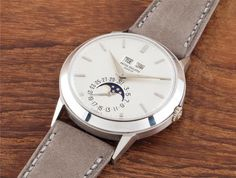 PHILLIPS : CH080215, Patek Philippe, A very fine and rare white gold perpetual calendar wristwatch with moon phases