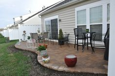 What was a small, uninviting back patio area is now an elegant stone paver patio.