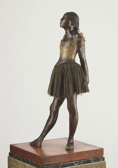 """Happy birthday to Edgar Degas. Although most recognized for his paintings, the French artist also explored sculpture. The original wax version of this bronze ballerina caused somewhat of a sensation when exhibited in 1881. Why do you think it was controversial?""""Little Dancer, Aged Fourteen,"""" executed in wax 1878–81, cast in bronze after 1922, by Hilaire-Germain-Edgar Degas"""
