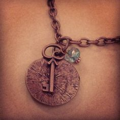 Copper pendent with skeleton key and beading on copper chain necklace. By Renewed Root.