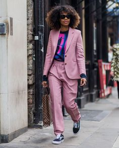 Matching sets have become key for getting out the door in a rush, and nothing is as effortlessly chic as a power suit. It can be hard to find the perfect fit, but when you do, life is but a breeze. Adding a graphic tee makes the casual look instantly cool.